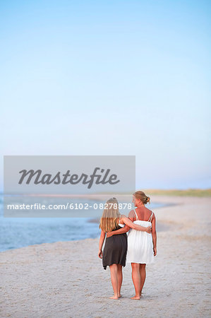 Mother with daughter walking on beach Stock Photo - Premium Royalty-Free, Image code: 6102-08278878