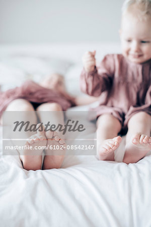Brother and sister on bed Stock Photo - Premium Royalty-Free, Image code: 6102-08542147