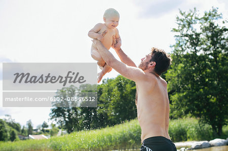 Father playing with son Stock Photo - Premium Royalty-Free, Image code: 6102-08566512