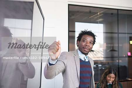 Businessman during presentation in office