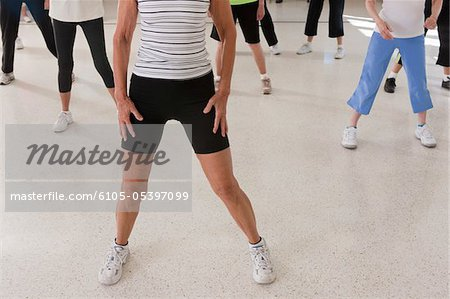 Seniors exercising in a health club Stock Photo - Premium Royalty-Free, Image code: 6105-05397099