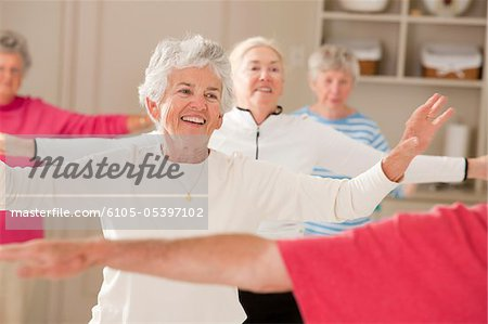 Seniors doing arm strengthening exercises in a health club Stock Photo - Premium Royalty-Free, Image code: 6105-05397102