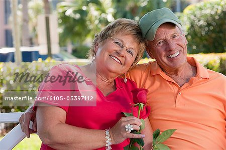 Portrait of a couple smiling Stock Photo - Premium Royalty-Free, Image code: 6105-05397112