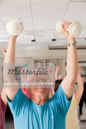 Senior exercise class doing arm stretches Stock Photo - Premium Royalty-Free, Image code: 6105-05397148