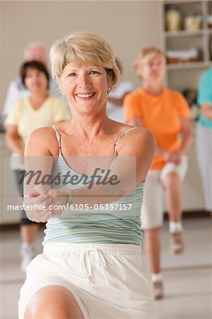 Senior exercise class doing stretches and cardio Stock Photo - Premium Royalty-Free, Image code: 6105-05397157