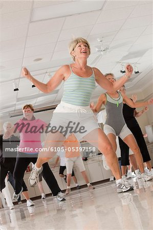 Senior exercise class doing stretches and cardio Stock Photo - Premium Royalty-Free, Image code: 6105-05397158