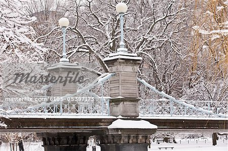 Snow covered trees with a footbridge in a public park, Boston Public Garden, Boston, Massachusetts, USA Stock Photo - Premium Royalty-Free, Image code: 6105-05397173