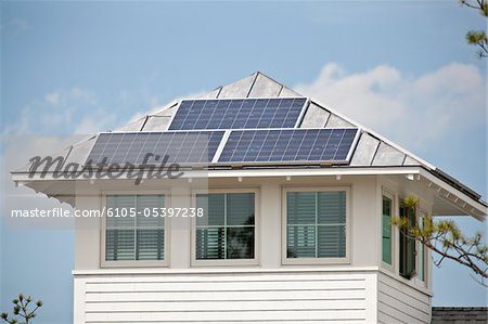 Solar electric power panels on roof of Green Technology Home Stock Photo - Premium Royalty-Free, Image code: 6105-05397238