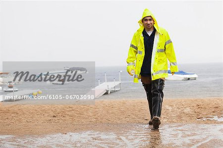 Public works engineer carrying water sample packet from lake, Portland, Maine, USA Stock Photo - Premium Royalty-Free, Image code: 6105-06703098