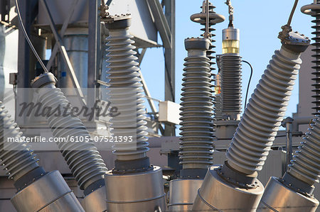 High voltage transformers at electric plant Stock Photo - Premium Royalty-Free, Image code: 6105-07521393