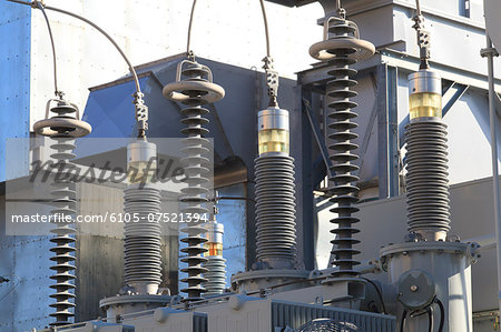 High voltage transformers at electric plant Stock Photo - Premium Royalty-Free, Image code: 6105-07521394