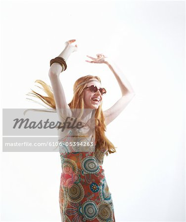 Young woman dancing. Stock Photo - Premium Royalty-Free, Image code: 6106-05394263