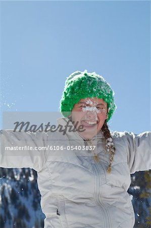 girl licking snow Stock Photo - Premium Royalty-Free, Image code: 6106-05403837
