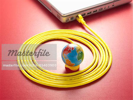 Yellow LAN cable and a globe. Stock Photo - Premium Royalty-Free, Image code: 6106-05403900