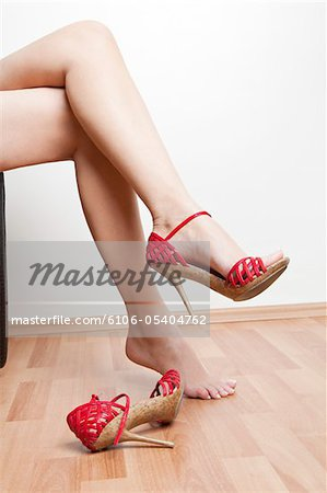 Sexy Red Shoe Stock Photo - Premium Royalty-Free, Image code: 6106-05404762