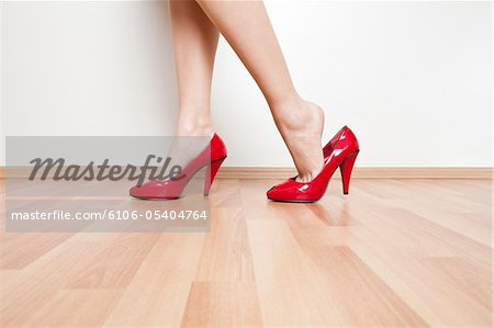 Women wearing sexy red shoe Stock Photo - Premium Royalty-Free, Image code: 6106-05404764