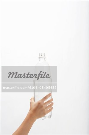 Hand of child who has PET bottle Stock Photo - Premium Royalty-Free, Image code: 6106-05405632