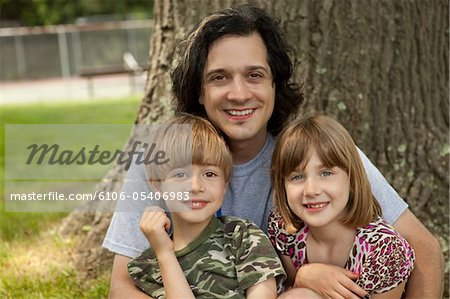 Happy Father With Children Stock Photo - Premium Royalty-Free, Image code: 6106-05406983