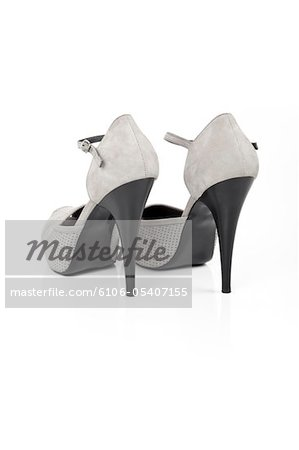 Gray high heeled shoe Stock Photo - Premium Royalty-Free, Image code: 6106-05407155