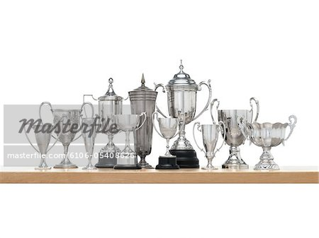 11n Silver trophies on maple shelf Stock Photo - Premium Royalty-Free, Image code: 6106-05408626