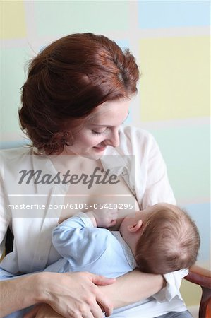young mother breast feeding her baby boy Stock Photo - Premium Royalty-Free, Image code: 6106-05410295
