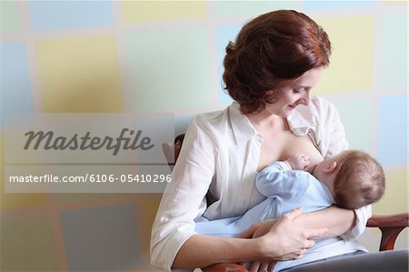 young mother breast feeding her baby boy Stock Photo - Premium Royalty-Free, Image code: 6106-05410296