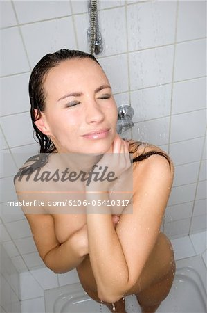 woman taking shower Stock Photo - Premium Royalty-Free, Image code: 6106-05410317