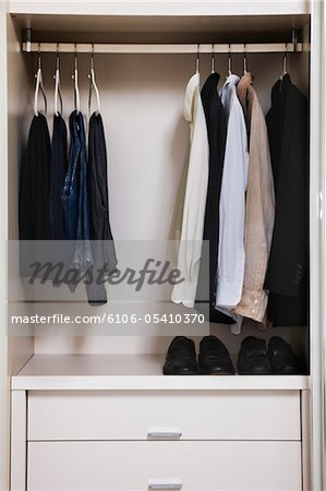view of a tidy male wardrobe Stock Photo - Premium Royalty-Free, Image code: 6106-05410370