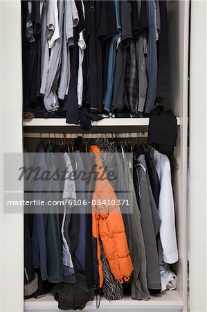 View of an untidy male wardrobe Stock Photo - Premium Royalty-Free, Image code: 6106-05410371