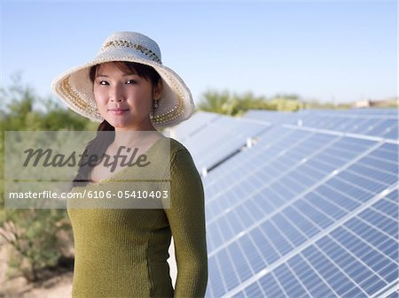 Woman with Solar Panels Stock Photo - Premium Royalty-Free, Image code: 6106-05410403