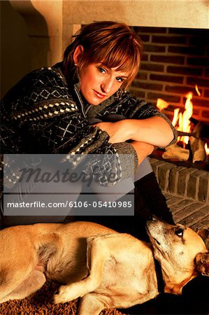 quiet moment at the fireplace Stock Photo - Premium Royalty-Free, Image code: 6106-05410985