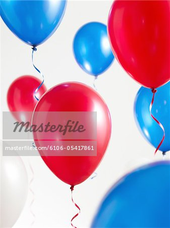 Red White and Blue Balloons with Streamers Stock Photo - Premium Royalty-Free, Image code: 6106-05417861
