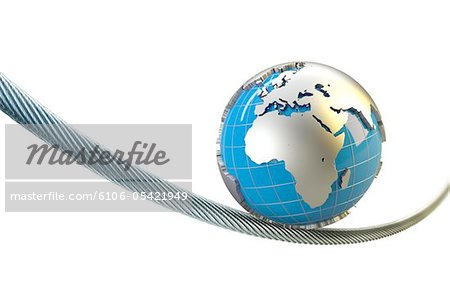globe with Europe Africa balances on a wire rope Stock Photo - Premium Royalty-Free, Image code: 6106-05421949