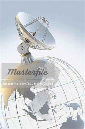 Radio telescope on top of a globe Stock Photo - Premium Royalty-Free, Image code: 6106-05421974