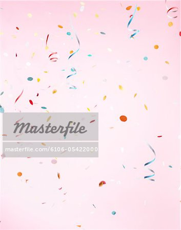Multicolored Confetti on Pink Background Stock Photo - Premium Royalty-Free, Image code: 6106-05422000