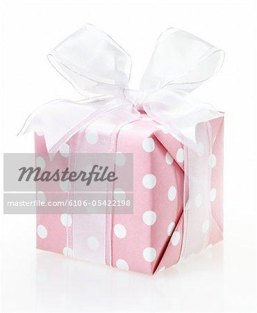 Pink Polka Dot Gift on White Background