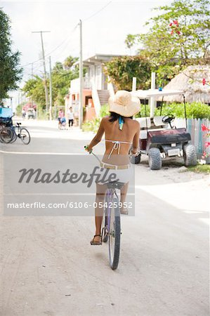 Woman riding bicycle Stock Photo - Premium Royalty-Free, Image code: 6106-05425952