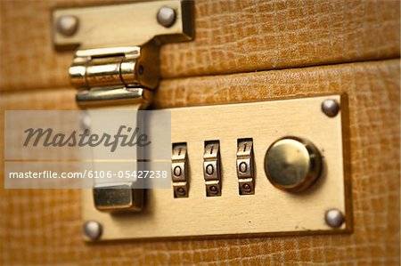 Golden Briefcase Lock Close Up Stock Photo - Premium Royalty-Free, Image code: 6106-05427238