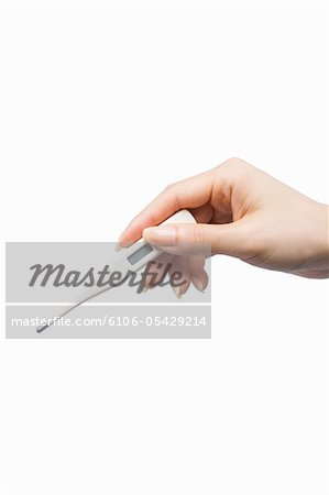 Close-up of hand with clinical thermometer Stock Photo - Premium Royalty-Free, Image code: 6106-05429214