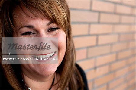 Plus Size woman smiling Stock Photo - Premium Royalty-Free, Image code: 6106-05430143