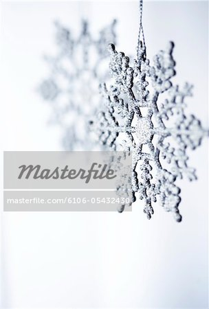 snowflake Christmas ornament on white background Stock Photo - Premium Royalty-Free, Image code: 6106-05432430