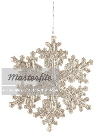 Silver Glitter Snowflake Holiday Ornament Stock Photo - Premium Royalty-Free, Image code: 6106-05436156