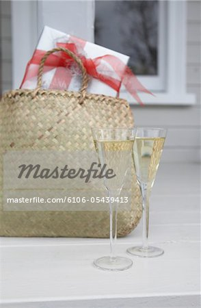 Glasses of Champagne and present Stock Photo - Premium Royalty-Free, Image code: 6106-05439413