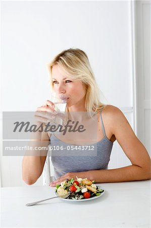 Woman drinking water Stock Photo - Premium Royalty-Free, Image code: 6106-05443712