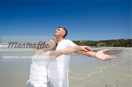 Mature couple on the beach Stock Photo - Premium Royalty-Free, Image code: 6106-05444569