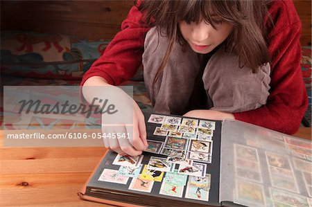 Collecting stamps Stock Photo - Premium Royalty-Free, Image code: 6106-05445541