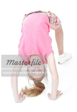 Bend over backwards Stock Photo - Premium Royalty-Free, Image code: 6106-05446355
