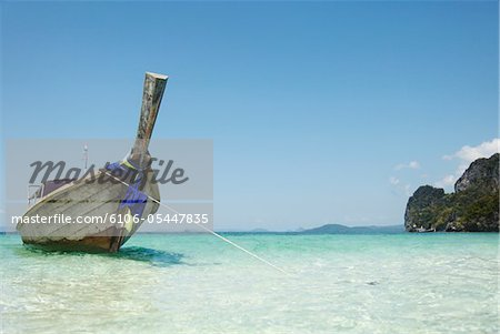 Longtail Boat Moored Stock Photo - Premium Royalty-Free, Image code: 6106-05447835