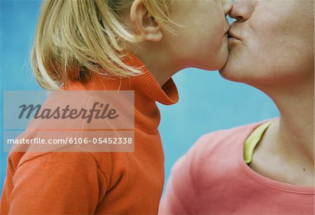 Daughter (3-5) kissing mother, close-up Stock Photo - Premium Royalty-Free, Image code: 6106-05452338