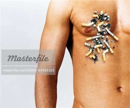 Man with cigarette butts and ash over chest, mid section Stock Photo - Premium Royalty-Free, Image code: 6106-05453152